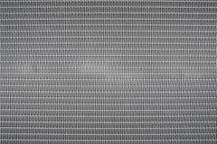 Φύλλο υποβάθρου του μετάλλου που καλύπτεται με τις αφηρημένες γραμμές και τις τρύπες Στοκ εικόνες με δικαίωμα ελεύθερης χρήσης