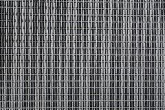 Φύλλο υποβάθρου του μετάλλου που καλύπτεται με τις αφηρημένες γραμμές και τις τρύπες Στοκ Εικόνα