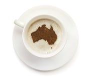 Φλιτζάνι του καφέ με τον αφρό και σκόνη με μορφή της Αυστραλίας (SE Στοκ Φωτογραφίες