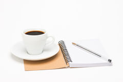 Φλιτζάνι του καφέ με το σημειωματάριο Στοκ Εικόνες