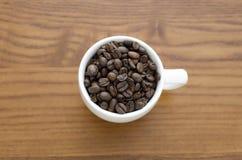 Φλιτζάνι του καφέ σε έναν πίνακα Στοκ Εικόνες