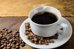 Φλυτζάνι καφέ και φασόλια καφέ Στοκ Φωτογραφία