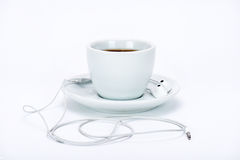 Φλυτζάνι με το ακουστικό Στοκ Φωτογραφίες
