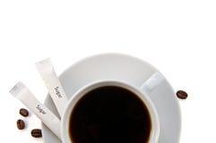 Φλυτζάνι της μαύρης κινηματογράφησης σε πρώτο πλάνο καφέ Στοκ Φωτογραφία