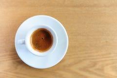 Φλυτζάνι του καφέ espresso στον ξύλινο πίνακα Στοκ Εικόνες