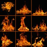 Φλόγες πυρκαγιάς στο Μαύρο Στοκ Εικόνες