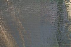 Χάλυβας που συσκευάζεται με το φύλλο αλουμινίου Ενισχυμένη ταινία φύλλων αλουμινίου Εκλεκτής ποιότητας δημιουργικό υπόβαθρο στοκ εικόνες με δικαίωμα ελεύθερης χρήσης