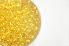 Χάπια βιταμινών (Α, Δ, Ε, πετρέλαιο ψαριών) Στοκ Εικόνες