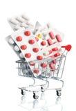 Χάπια σε ένα καροτσάκι αγορών υπεραγορών Στοκ Εικόνα
