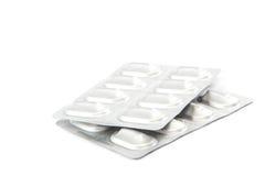 Χάπια στα πακέτα φουσκαλών στο άσπρο υπόβαθρο στοκ φωτογραφία με δικαίωμα ελεύθερης χρήσης