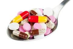 Χάπια στο κουτάλι Στοκ Εικόνες