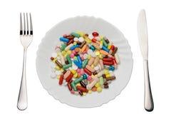 Χάπια στο πιάτο Στοκ Φωτογραφία