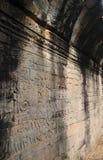 Χάραξη πετρών τοίχων σε έναν Bayon ναό Angkor Thom Στοκ εικόνα με δικαίωμα ελεύθερης χρήσης
