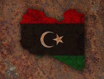 Χάρτης και σημαία της Λιβύης στο σκουριασμένο μέταλλο Στοκ Εικόνα