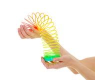 Χέρια γυναίκας που κρατούν την άνοιξη παιχνιδιών Στοκ φωτογραφία με δικαίωμα ελεύθερης χρήσης