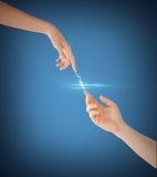 Χέρια γυναικών και ανδρών Στοκ Εικόνες