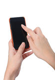 Χέρια γυναικών σχετικά με το smartphone που απομονώνεται στο άσπρο υπόβαθρο Στοκ εικόνες με δικαίωμα ελεύθερης χρήσης