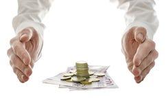 Χέρια γύρω από τα ευρο- χρήματα Στοκ Εικόνες