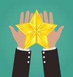 Χέρια επιχειρηματιών που δίνουν το χρυσό αστέρι απεικόνιση αποθεμάτων