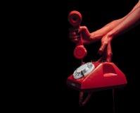 Χέρια διαβόλων με το αναδρομικό τηλέφωνο Στοκ Εικόνα