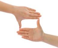 χέρια πλαισίων που γίνοντα Στοκ Εικόνες