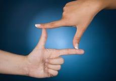 χέρια πλαισίων Στοκ εικόνες με δικαίωμα ελεύθερης χρήσης