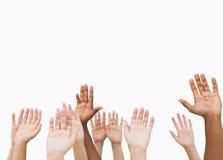 Χέρια που αυξάνουν στον αέρα Στοκ φωτογραφία με δικαίωμα ελεύθερης χρήσης