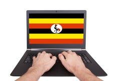 Χέρια που λειτουργούν στο lap-top, Ουγκάντα Στοκ εικόνα με δικαίωμα ελεύθερης χρήσης