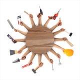 Χέρια που κρατούν τα εργαλεία στο άσπρο υπόβαθρο Στοκ Εικόνα