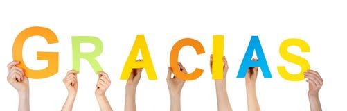 Χέρια που κρατούν τα gracias στοκ εικόνα με δικαίωμα ελεύθερης χρήσης