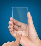 Χέρια που κρατούν το φουτουριστικό διαφανές κινητό τηλέφωνο Στοκ Εικόνα