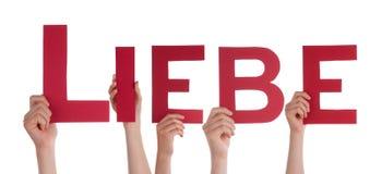 Χέρια που κρατούν το Word Liebe Στοκ Φωτογραφία