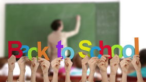 Χέρια που κρατούν ψηλά πίσω στο σχολείο απόθεμα βίντεο