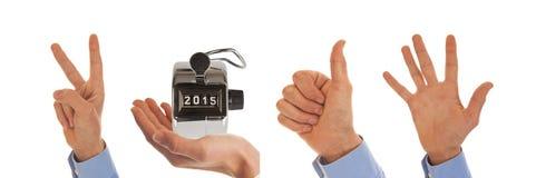 Χέρια που λογαριάζουν το έτος 2015 Στοκ φωτογραφία με δικαίωμα ελεύθερης χρήσης