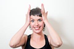 χέρια προσώπου που κρατούν την έκπληξη στη γυναίκα στοκ εικόνες με δικαίωμα ελεύθερης χρήσης