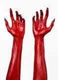 Χέρια του κόκκινου διαβόλου με τα μαύρα καρφιά, κόκκινα χέρια της Satan, θέμα αποκριών, σε ένα άσπρο υπόβαθρο, που απομονώνεται Στοκ εικόνες με δικαίωμα ελεύθερης χρήσης