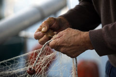 χέρια ψαράδων Στοκ Φωτογραφία