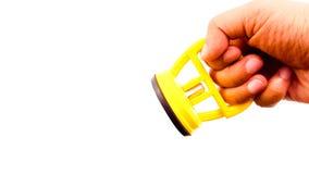 Χέρι ατόμων που κρατά κενό sucker στο κίτρινο χρώμα Στοκ φωτογραφία με δικαίωμα ελεύθερης χρήσης