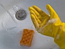 χέρι γαντιών κίτρινο Στοκ εικόνες με δικαίωμα ελεύθερης χρήσης