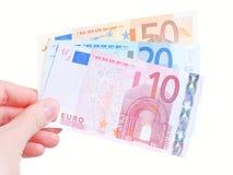 Χέρι γυναικών και ευρο- μετρητά τραπεζογραμματίων Στοκ Εικόνες