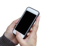 Χέρι γυναικών που κρατά και που χρησιμοποιεί κινητό, τηλέφωνο κυττάρων, έξυπνο τηλέφωνο με την απομονωμένη οθόνη Στοκ φωτογραφία με δικαίωμα ελεύθερης χρήσης