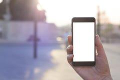 Χέρι γυναικών που κρατά το σύγχρονο σύγχρονο smartphone Στοκ Εικόνα