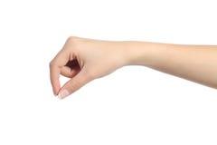 Χέρι γυναικών που κρεμά κάτι κενό στοκ φωτογραφία με δικαίωμα ελεύθερης χρήσης
