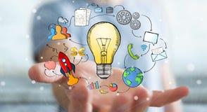 Χέρι εκμετάλλευσης επιχειρηματιών που σύρονται lightbulb και εικονίδια πολυμέσων Στοκ Εικόνα
