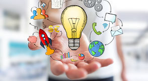 Χέρι εκμετάλλευσης επιχειρηματιών που σύρονται lightbulb και εικονίδια πολυμέσων Στοκ εικόνες με δικαίωμα ελεύθερης χρήσης