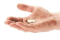 Χέρι επαιτών με μερικά νομίσματα Στοκ Εικόνες