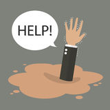 Χέρι επιχειρηματιών που βυθίζει σε μια λακκούβα της κινούμενης άμμου Στοκ Εικόνα
