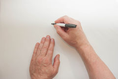 Χέρι και δείκτης Το χέρι ατόμων ` s γράφει Στοκ Φωτογραφίες