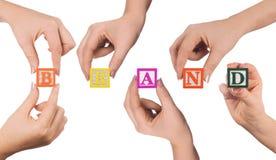 Χέρι και εμπορικό σήμα λέξης Στοκ Φωτογραφία