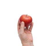Χέρι και μήλο Στοκ Εικόνες